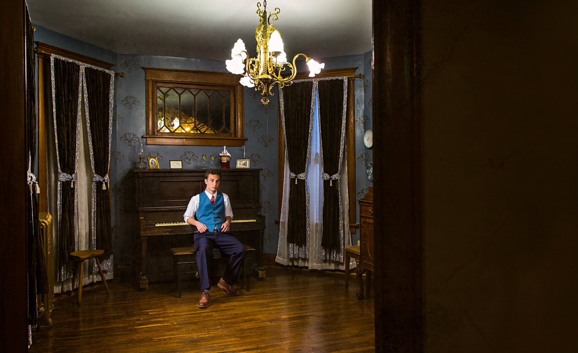 man in piano room