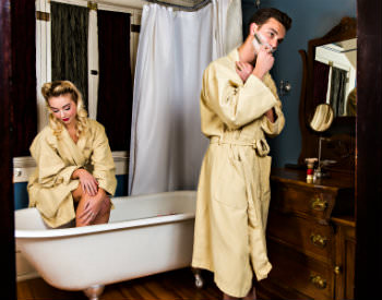 old fashioned couple in bathroom