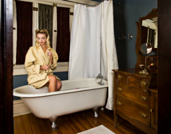 old fashioned young lady in tub